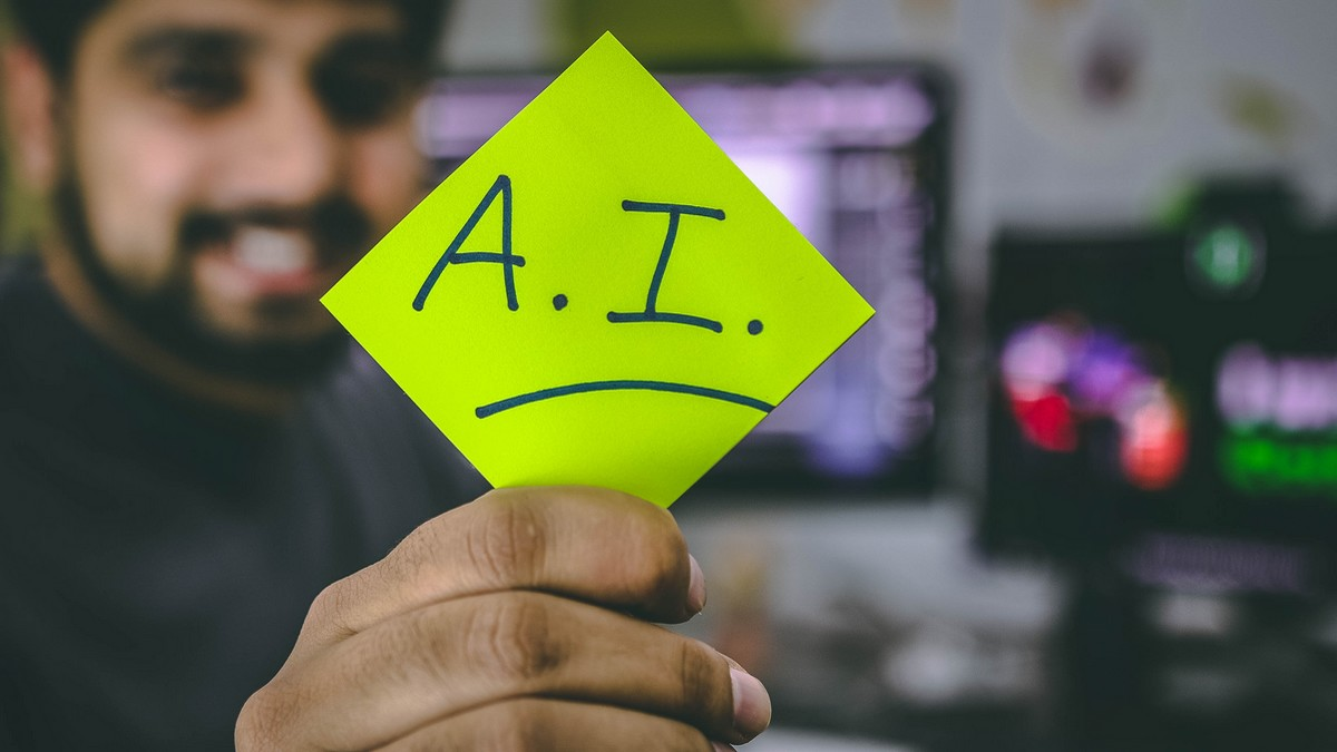 Muž ukazuje symbol A.I., což je umělá inteligence.